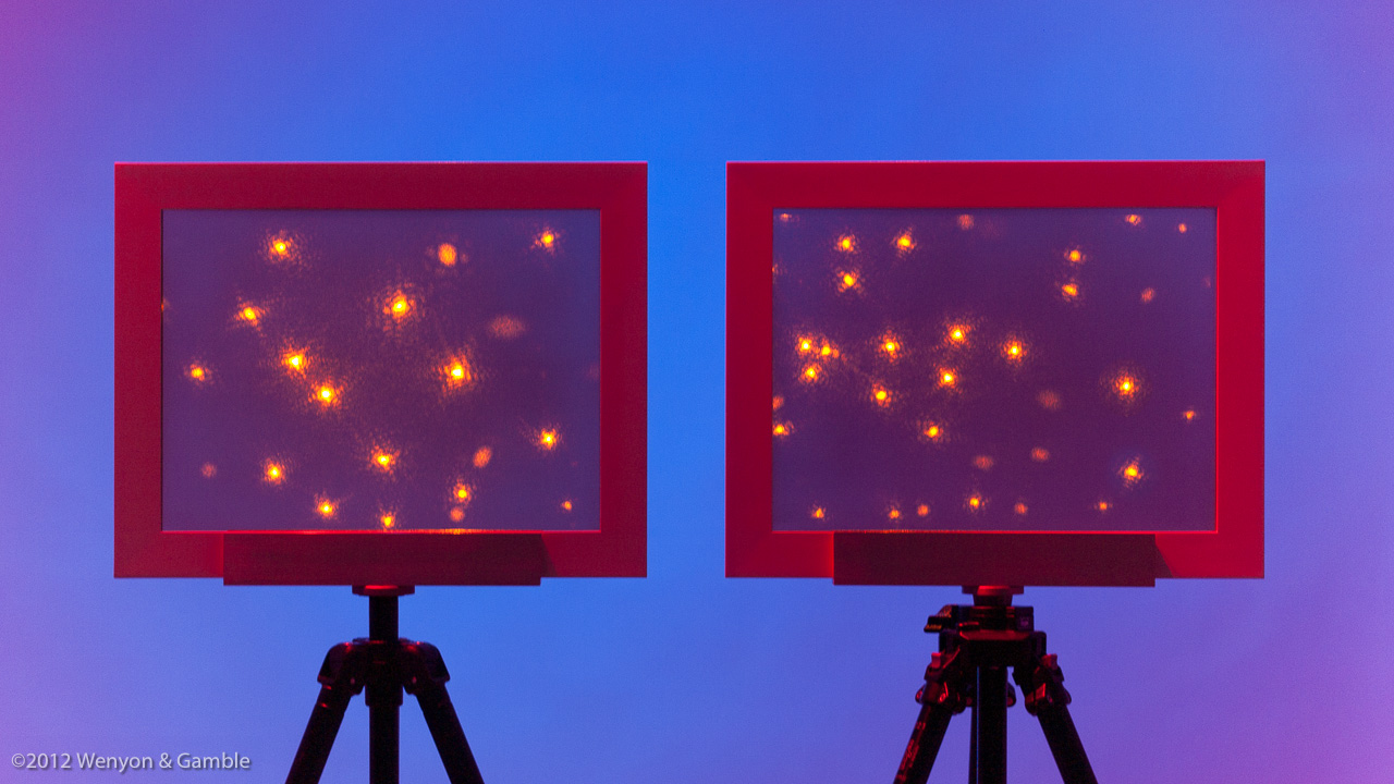 Little Points: First & Second Quadrants, Wenyon & Gamble, 2012. Two holograms (silver-halide emulsion on glass) in wood frames, mounted on tripods, installed with colored-light projection behind and illuminated by yellow lasers, 12.6 x 16.9 in (320 x 430 mm) in A Universe held up for Inspection
